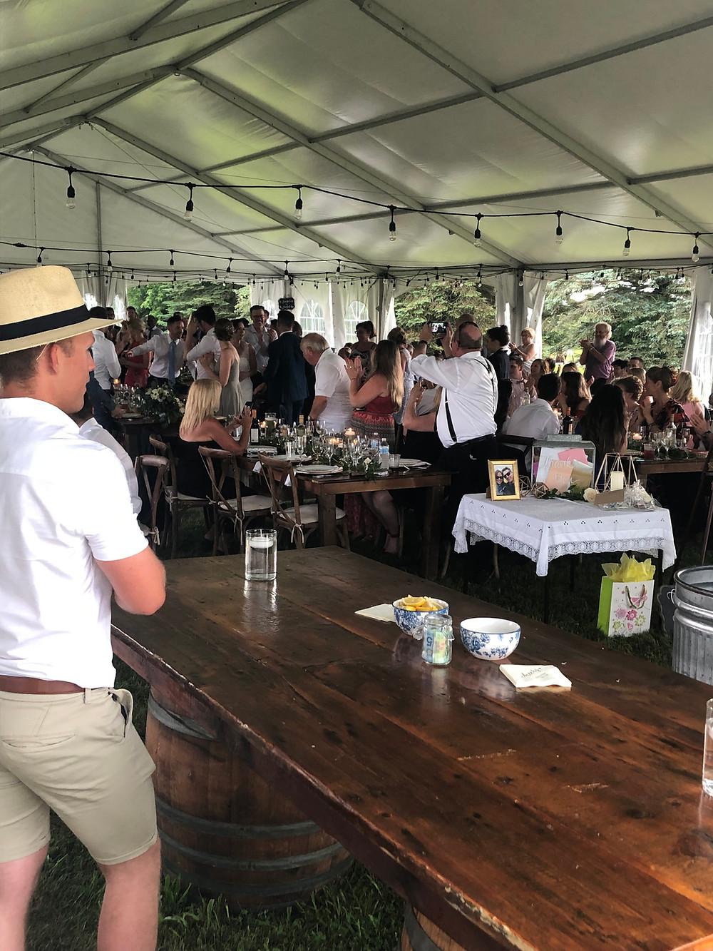 Bartender overlooks wedding reception in Ontario