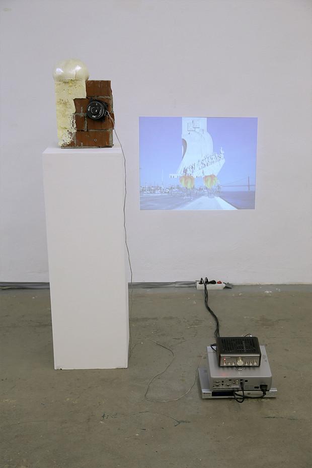 Installation: Bricks, Polyurethane, Speaker, Video