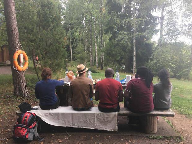 Gathering at the lake - break from program