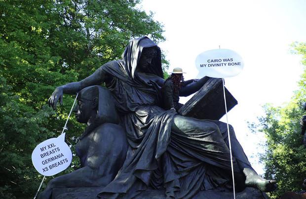 Performance by Marcio Carvalho, Ali Alfatlawi, Wathiq Al Ameri  /  Otto Von Bismarck statue, Tiergarten, Berlin