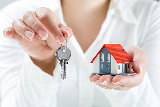 woman handing keys