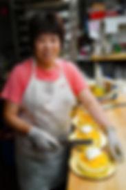 Chinatown woman working at cake store
