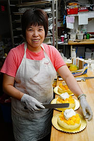 Chinatown woman working at cake store