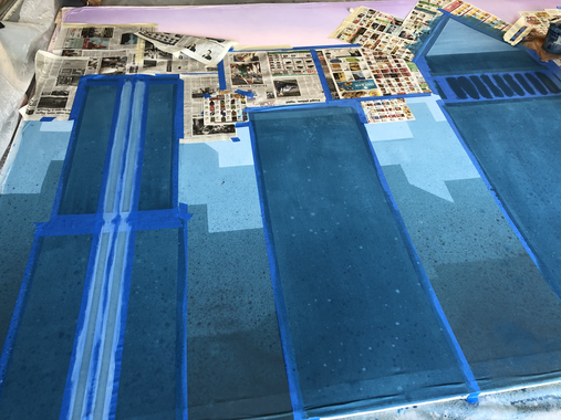 Adding detail to the main buildings.