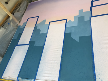 Painting the third layer of the background buildings.
