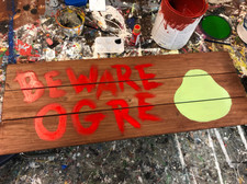 """Painting the """"Beware Ogre"""" sign."""