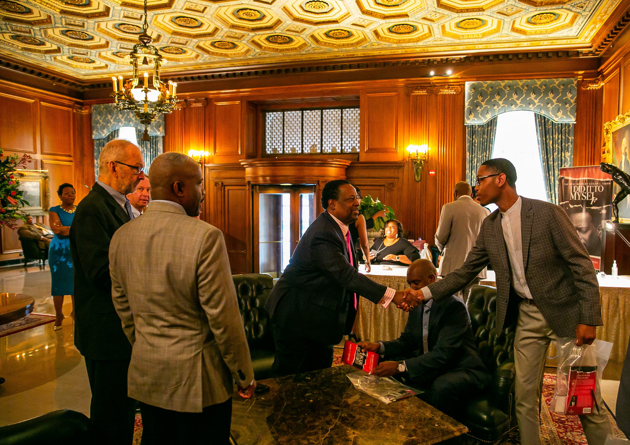 Edgar Vann greets guests at book signing event