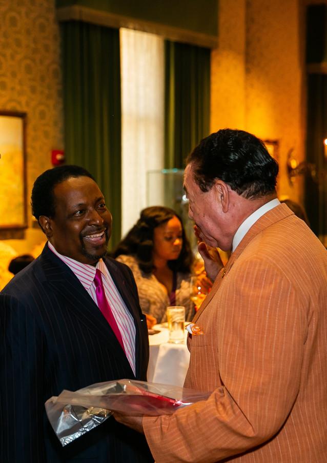 Marshall Bullock and Judge Craig Strong greet Edgar Vann at book signing event