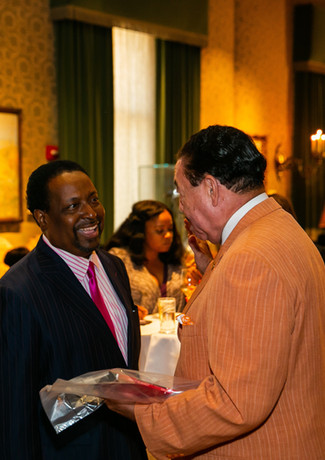 Marshall Bullock and Judge Craig Strong greet Edgar Vann at book signing event