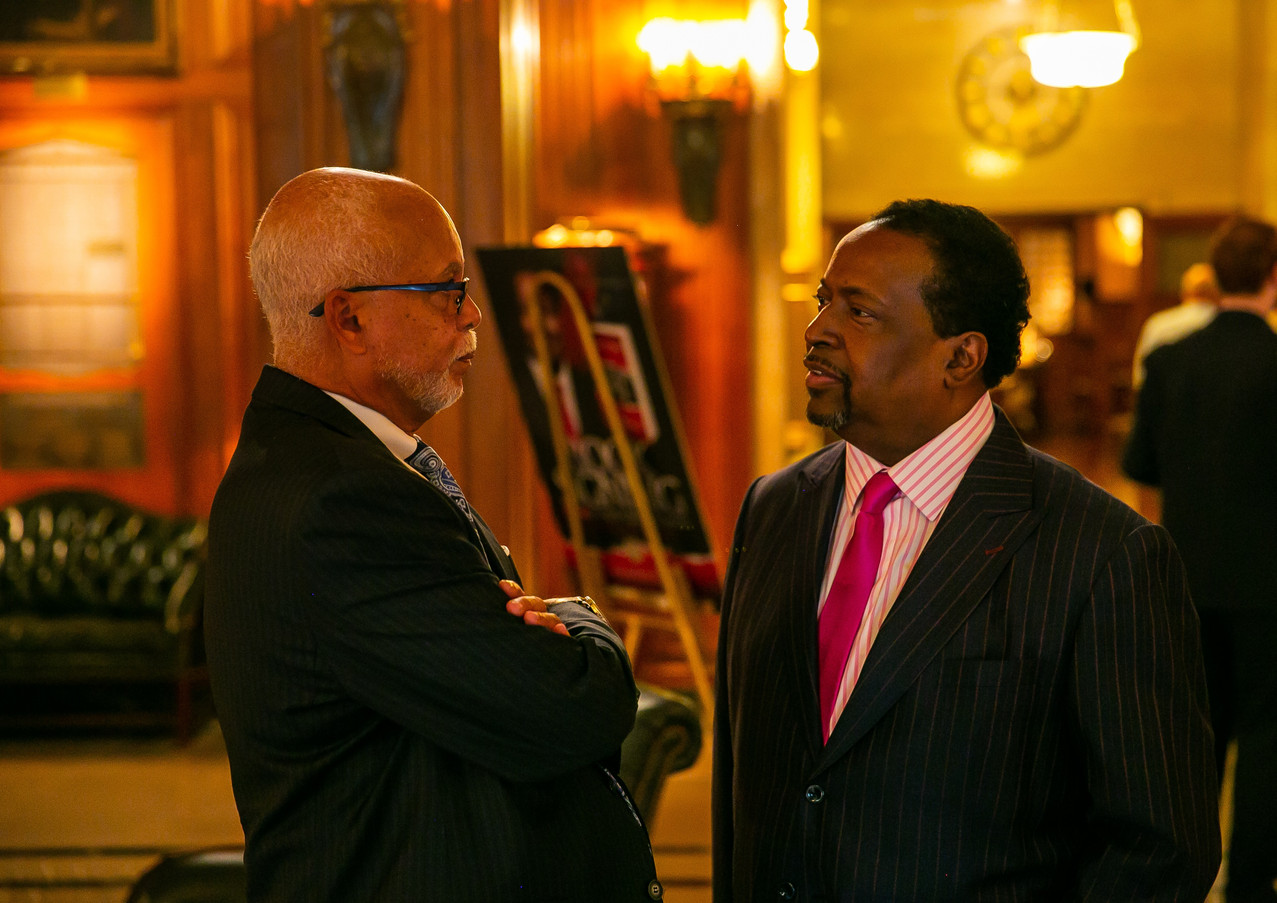 County Executive Warren Evans talks with Edgar Vann at book signing event