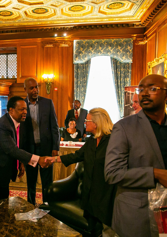 Edgar Vann greets Congresswoman Debbie Dingell at book signing event