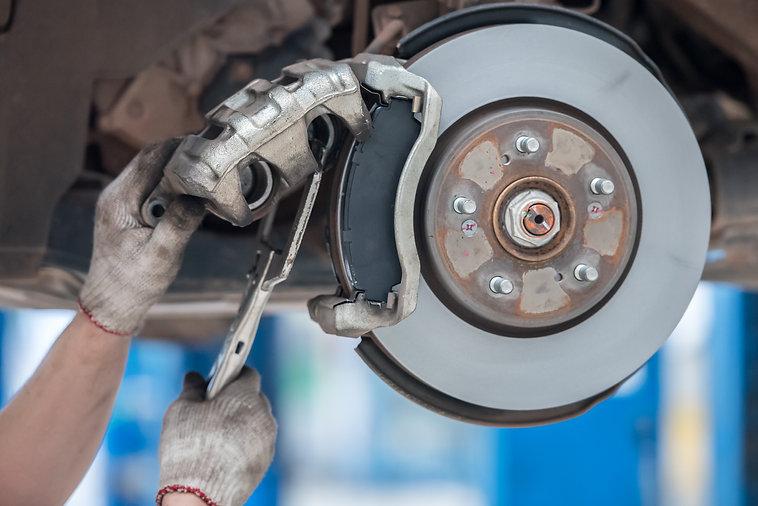 replacing-brake-pads-service-center-car-