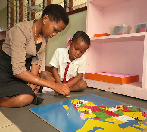 Head teacher Furaha giving support at Montessori Kindergarten