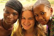 three volunteers at Montessori Kindergarten