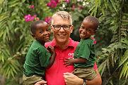 Founder Daniel Preuss at Streetkids Internationals Montessori Kindergarten with two children