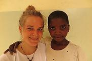 Louisa with orphan child at Tumaini Montessori Kindergarten