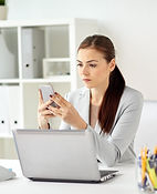 businesswoman-with-smartphone-at-office-