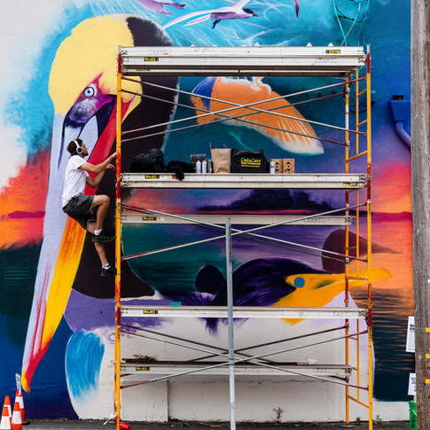 Nick Sweatmen paints his mural for the Eureka Street Art Festival