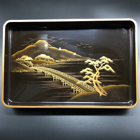 Black lacquered tray with gold decoration