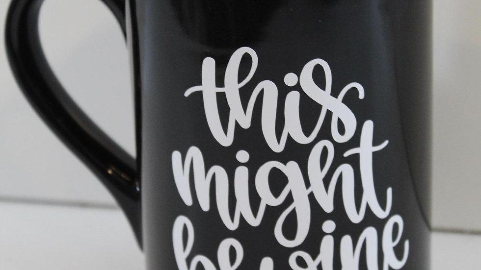 black mug this might be wine