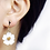 White Flower Clip On Earrings on Model