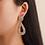 Gold Tone Textured Teardrop Clip Earrings on Model