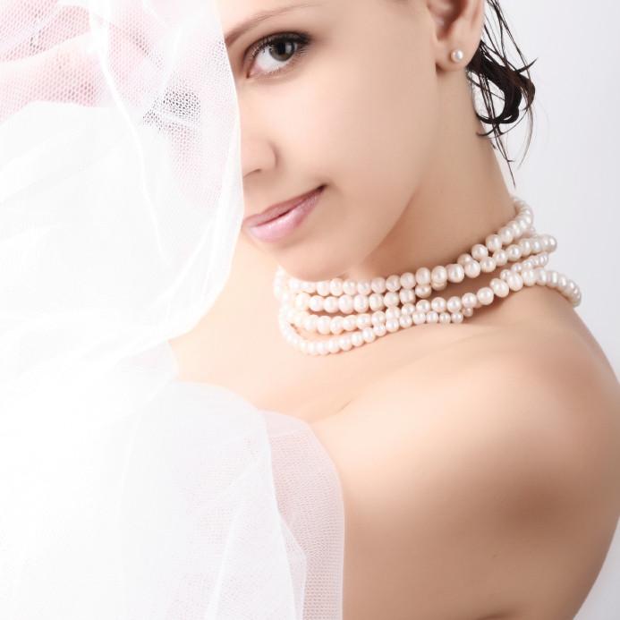 Dark Haired Girl Wearing Strings of Pearls