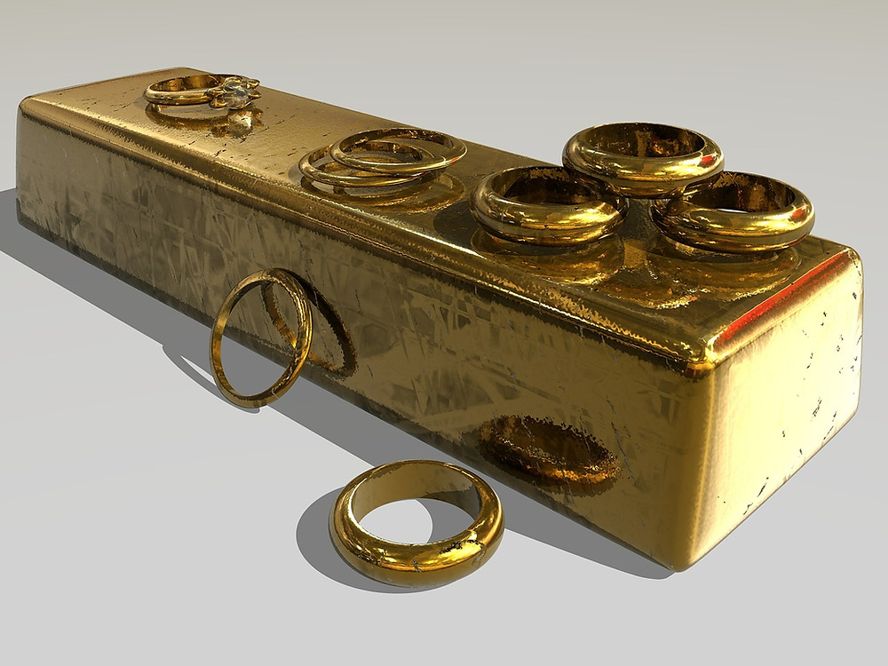 Gold Rings On A Bar of Pure Gold Bullion