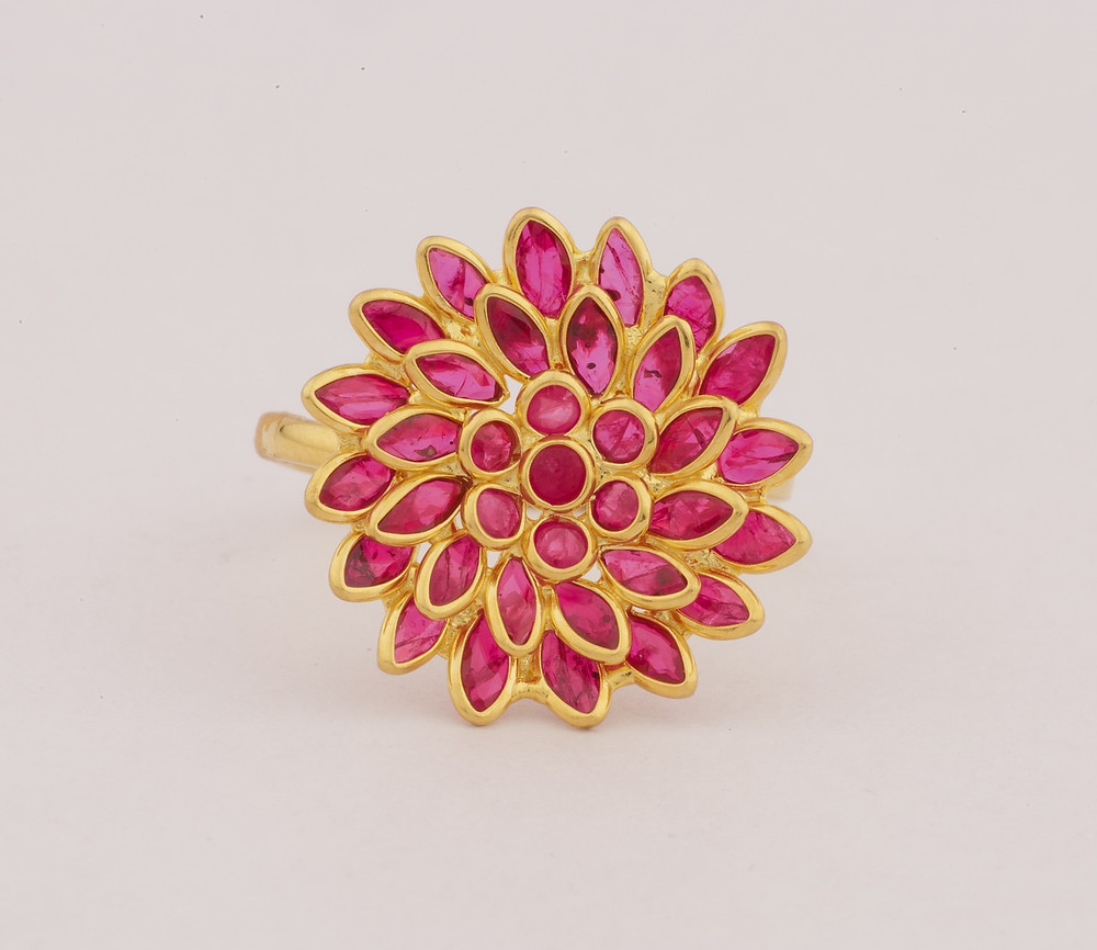 A ruby cluster gold ring.