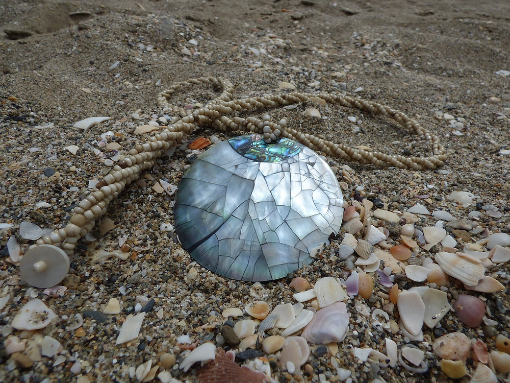 Mother of Pearl Pendant on a Beach