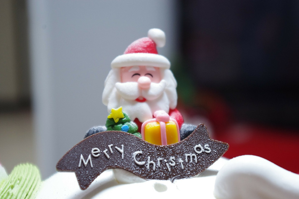 Confectionary Santa on a cake - Merry Christmas