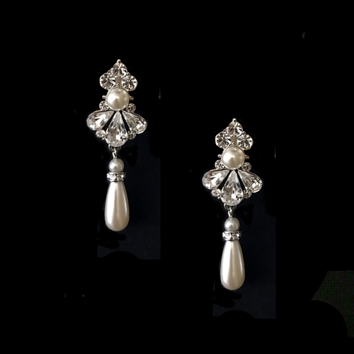 Exquisite Starlet Pearl Clip Earrings, black background