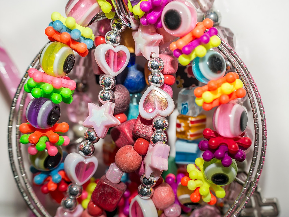 A Bowl of Children's Toy Jewellery
