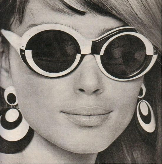 Black and White Image of Woman in Monochrome Earrings and Sunglasses