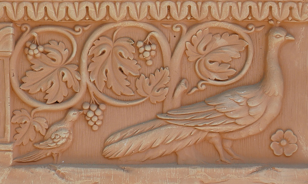 A terracotta wall plaque