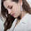Delicate Crystal Petals CZ Drop Earrings on model