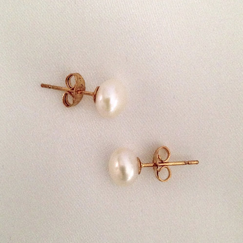 White freshwater pearl studs on gold plated posts, 7mm