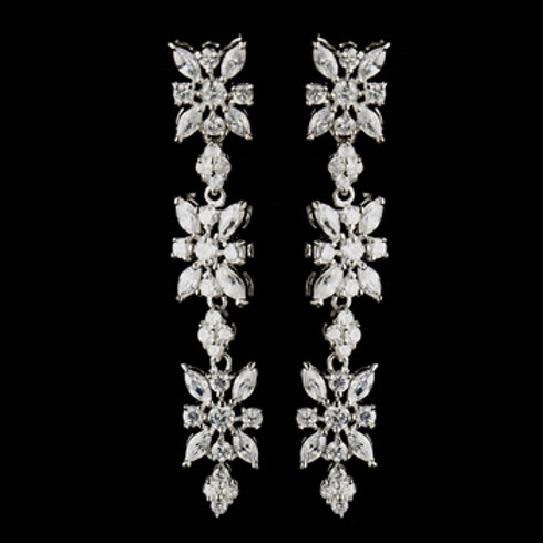 Long silver earrings with a floral cascade of marquis crystals