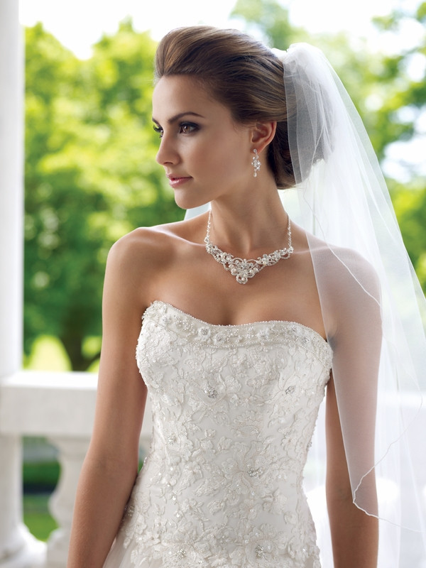 Bride Wearing Pearl Necklace and Earrings