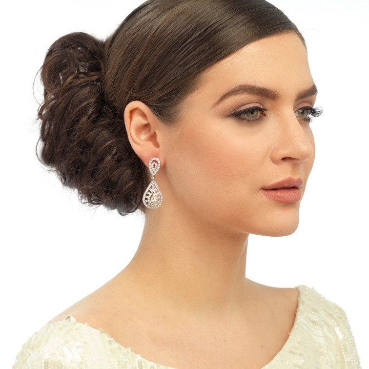 Model in Crystal Earrings that are available in both clip-on and pierced styles