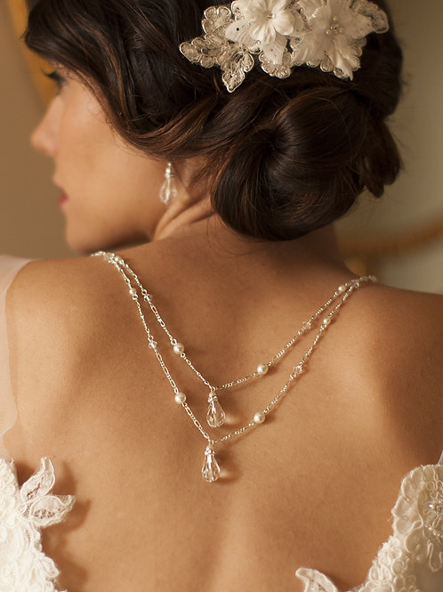 Ivory pearl and crystal back necklace set on bride