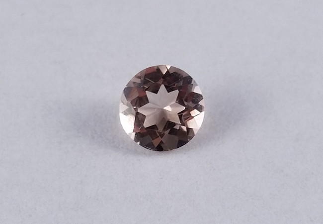 Facet Cut Axinite Gemstone in a Violet Brown Colour