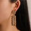 Gold Tone Textured Rectangle Drop Clip Earrings on Model