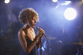 Profile shot of a female jazz singer on
