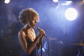 Profile shot of a female jazz singer on