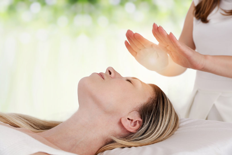 Woman having reiki healing treatment , a