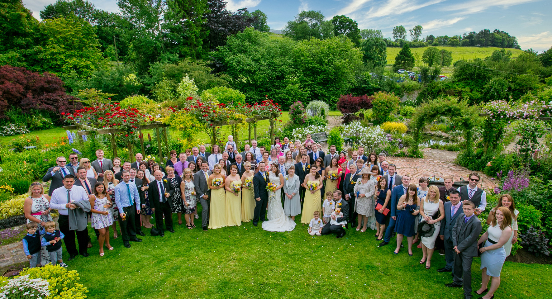 large wedding group lovely garden