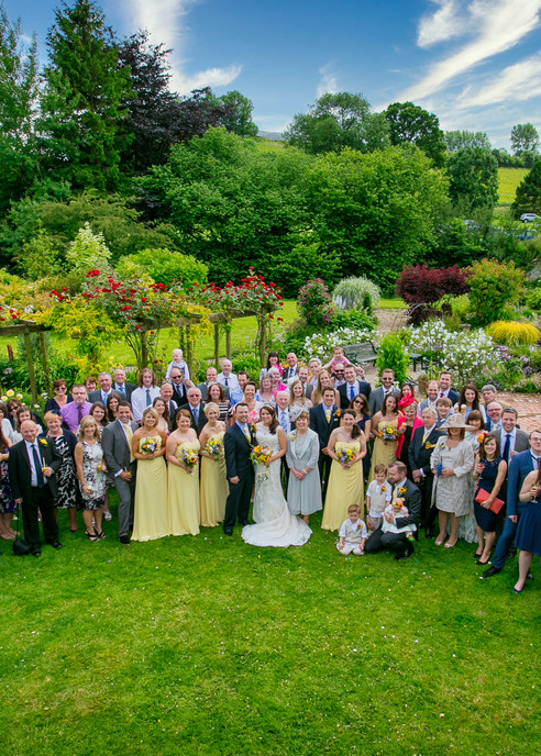 large wedding group lovely garden