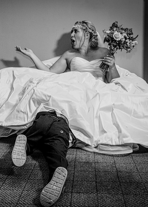 bride sit on floor boy hiding under dress