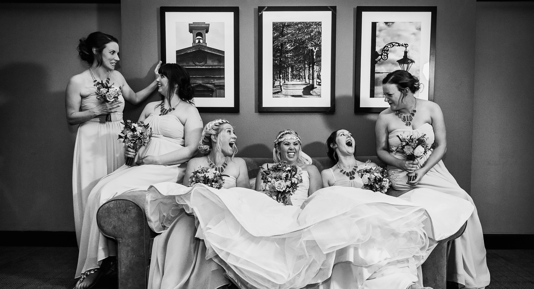 black and wite wedding party laughing